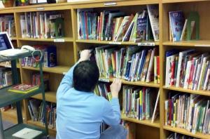 Jay shelving books