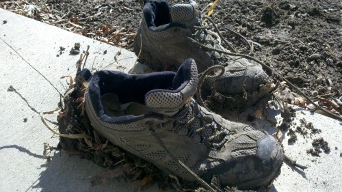 Shoes covered in Black Prairie Soil