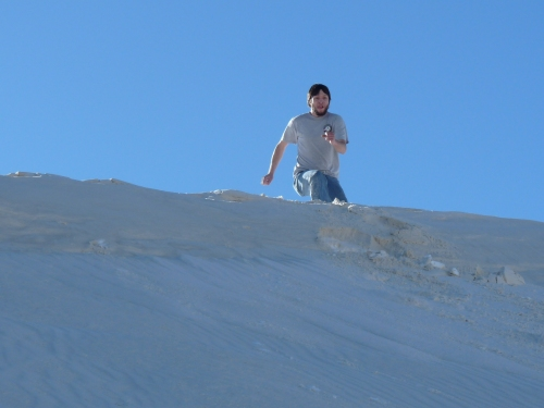 Jay jumping off the dunes