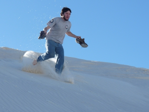 Jay running down the dunes