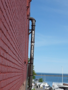 brewery sign with view of Lake Superior