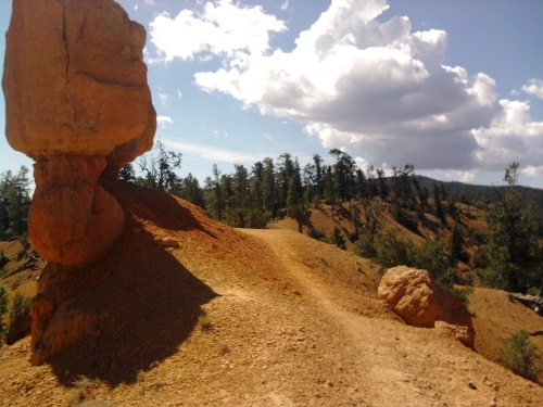 ridge line descent on thunder mountain trail, dixie national forest, ut
