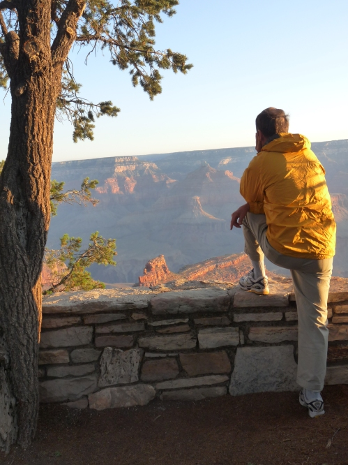 visitor watching sunrise on South Rim of the Grand Canyon