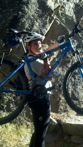 Sharon carrying bike on Walker Ranch Loop