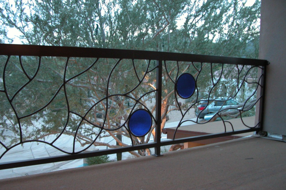 This is a view of a balcony railing with glass inlaid